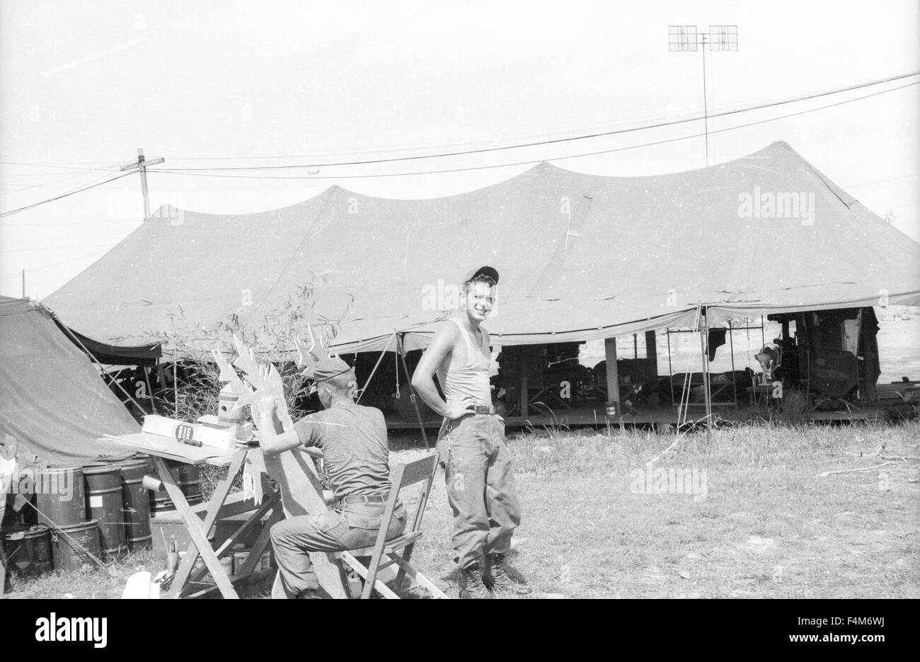 soldiers sitting outside table at a first infantry division base