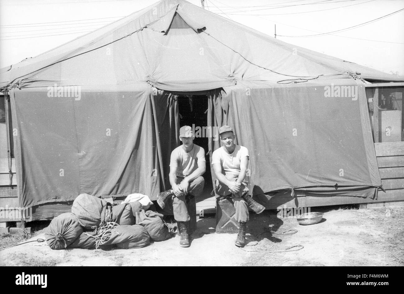 soldiers sitting outside tent at a first infantry division base camp
