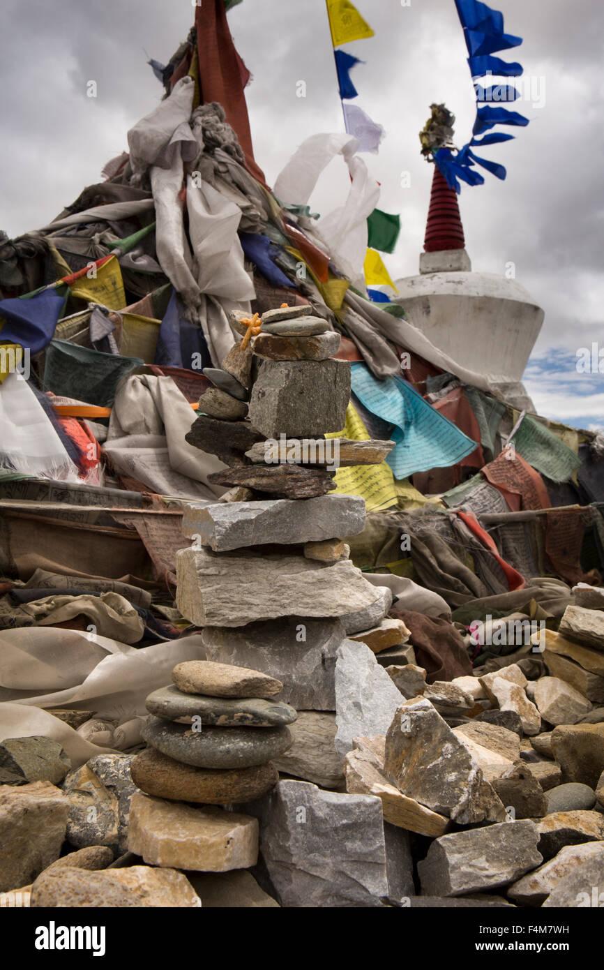 India, Jammu & Kashmir, Ladakh, Taglang La pass top, summit rock cairn and prayer flags - Stock Image