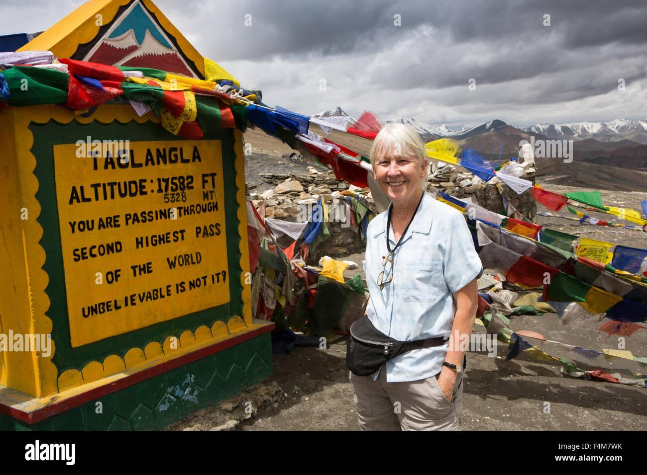 India, Jammu & Kashmir, Ladakh, Taglang La pass top, female tourist at summit sign - Stock Image