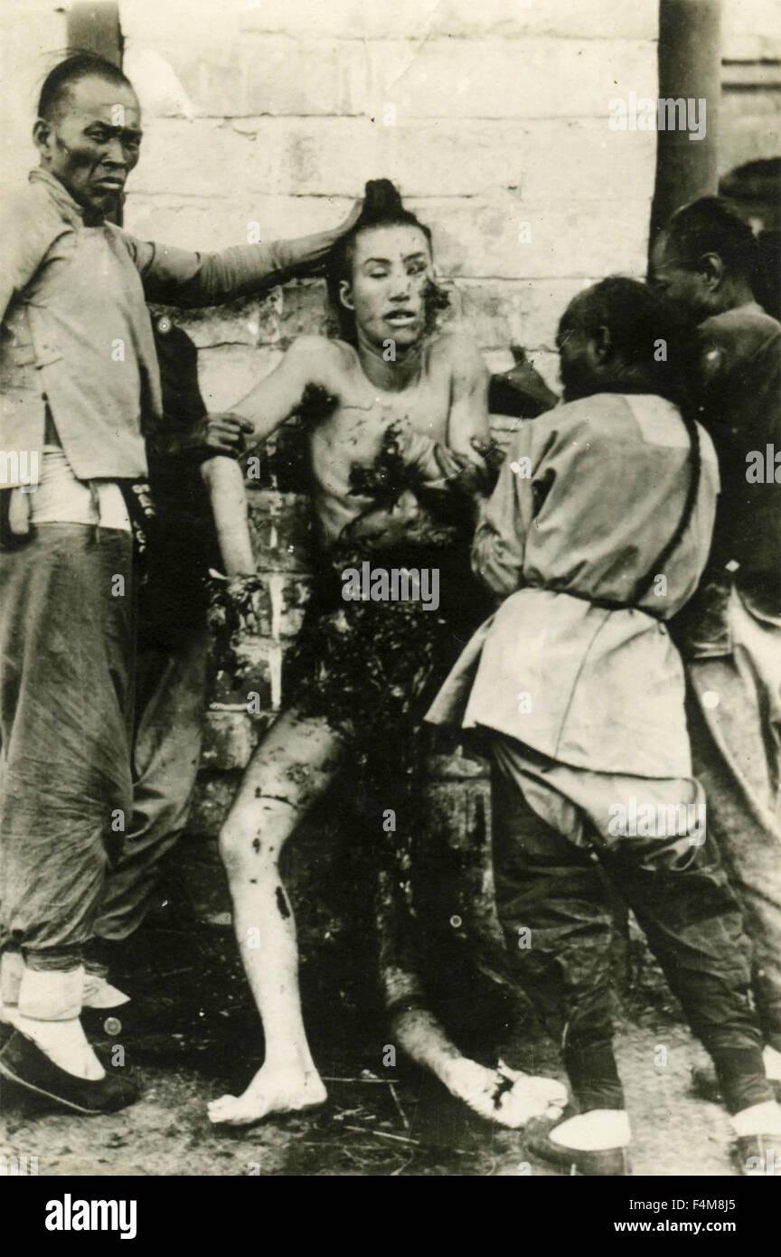 Chinese torture during Shanghai rebellion, China - Stock Image