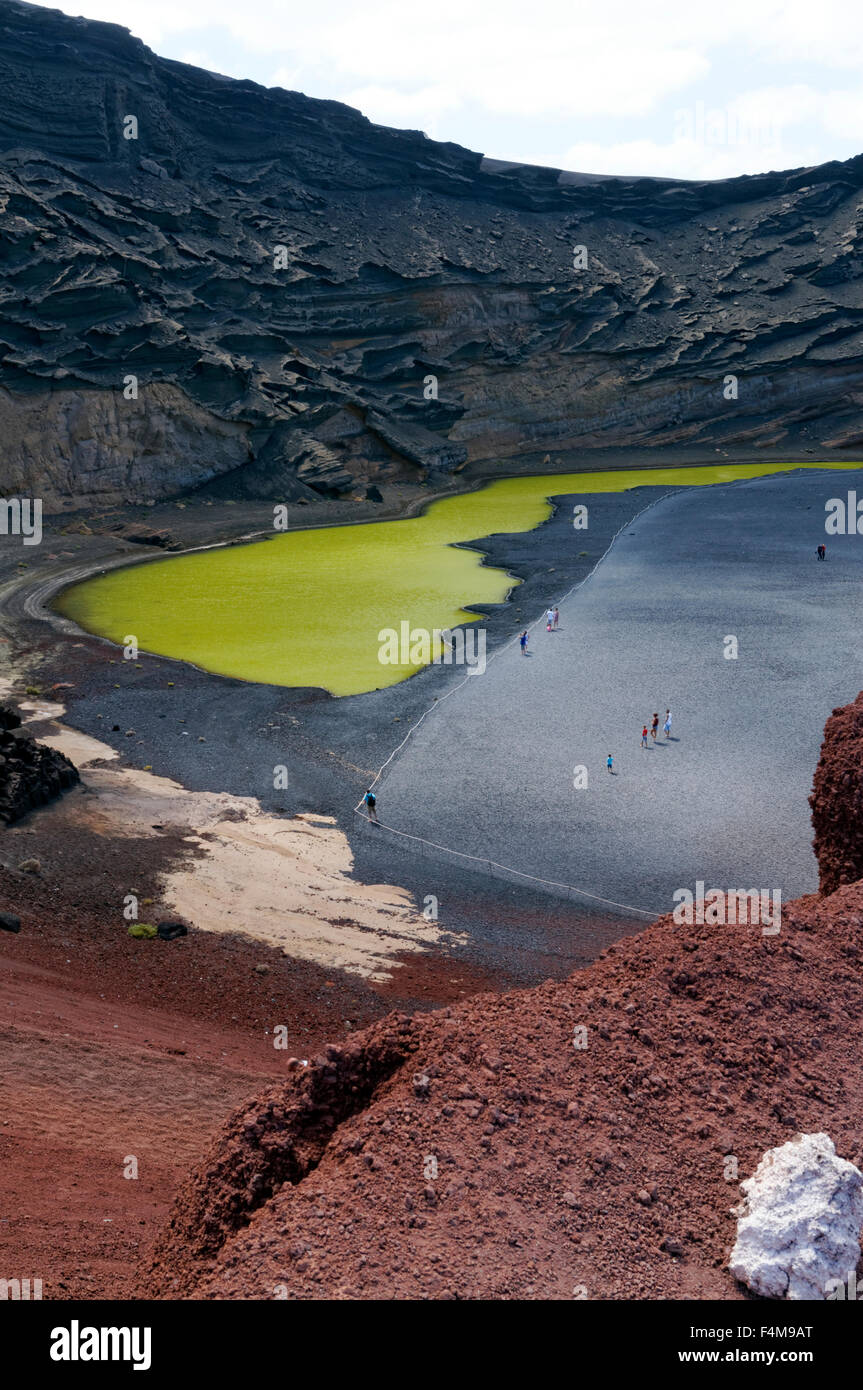 El Golfo and the strange lake coloured green through the acion of algae, Lanzarote, Canary Islands, Spain. - Stock Image