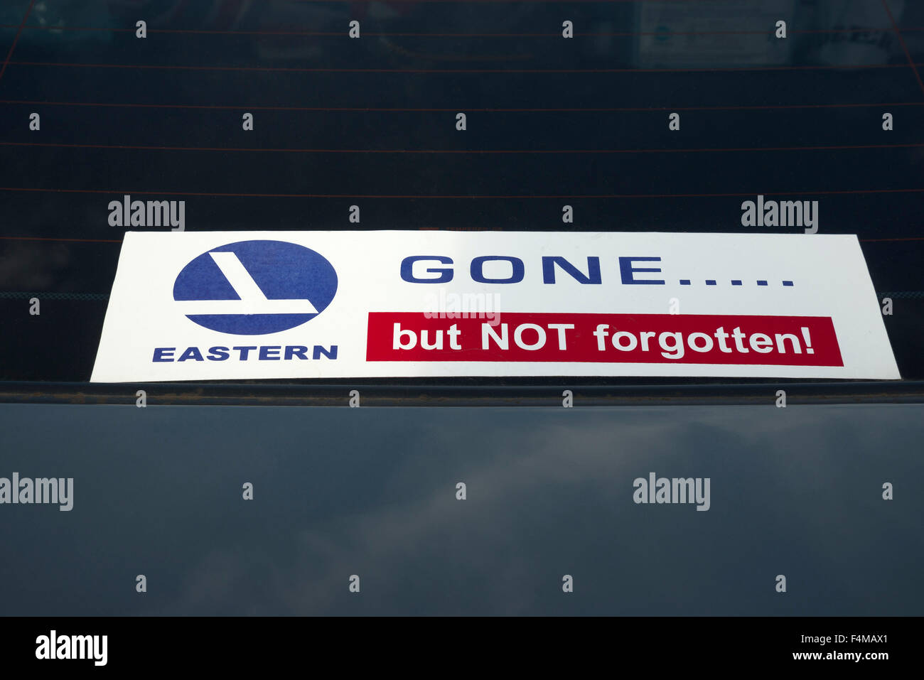 Eastern Airlines gone but not forgotten sticker in the rear windshield of an Eastern retiree's automobile. - Stock Image