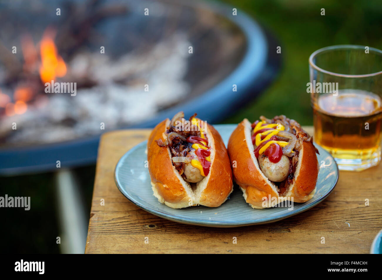 Hot dogs with fried onions - Stock Image