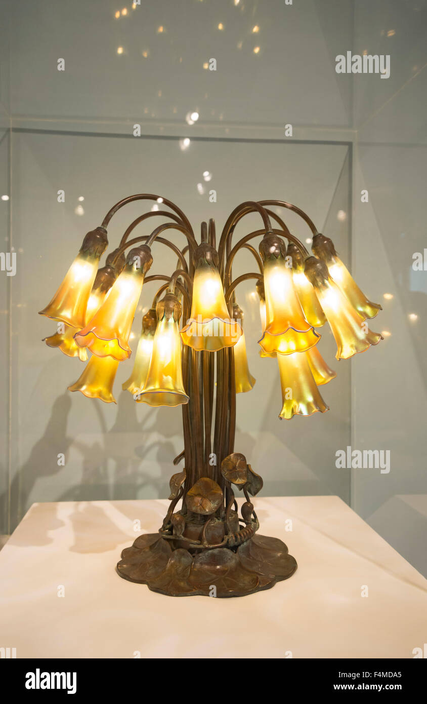Louis Comfort Tiffany, Eighteen-Light Pond Lily Lamp, 1902, of Favrile glass and bronze. - Stock Image