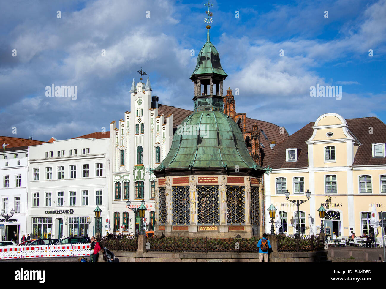 The Wasserkunst fountain pictured in front of historical gabled houses on the market square located in the historic - Stock Image