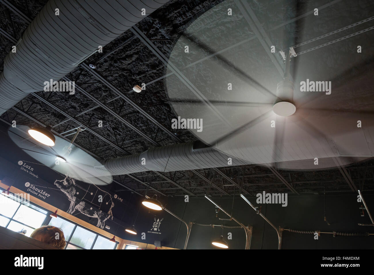 Brand new open-air interior of Sonny's BBQ restaurant sports humongous industrial strength and sized ceiling - Stock Image