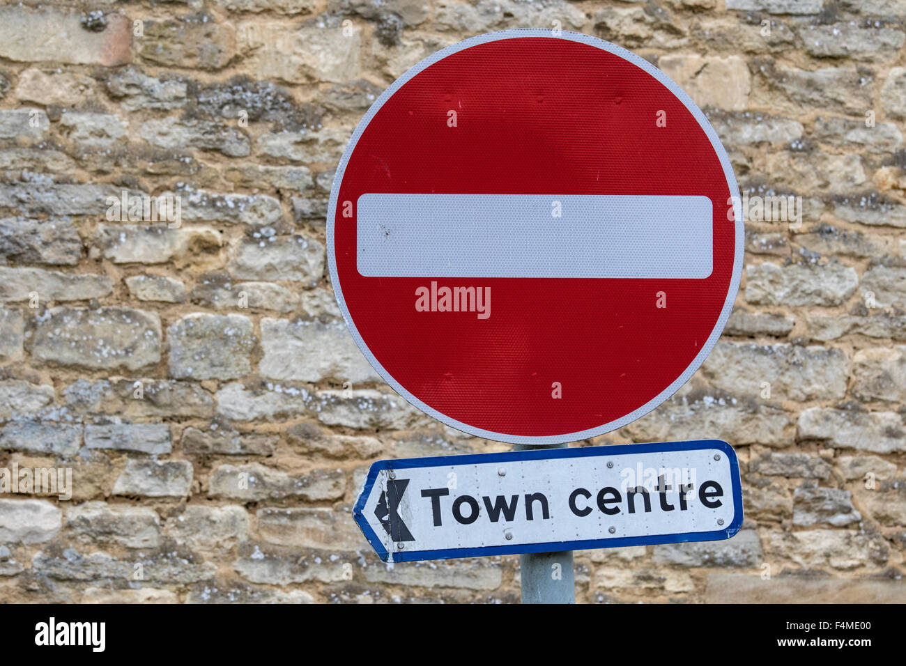 Pointing the way to the town centre via a no entry sign, England, UK - Stock Image