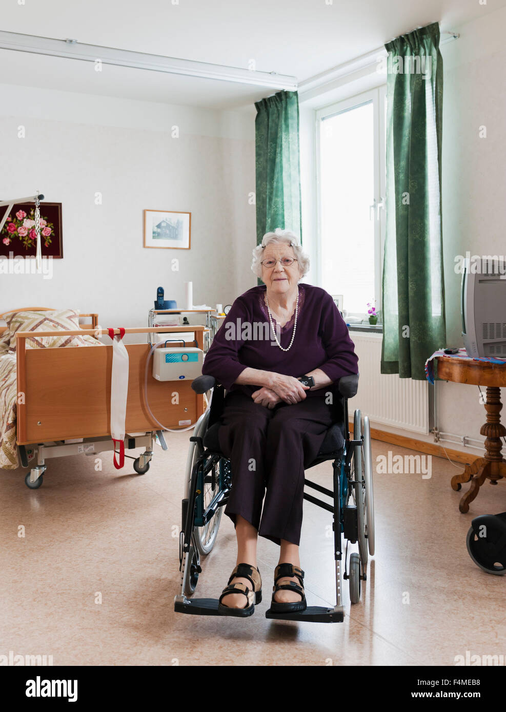 Senior woman in her flat - Stock Image