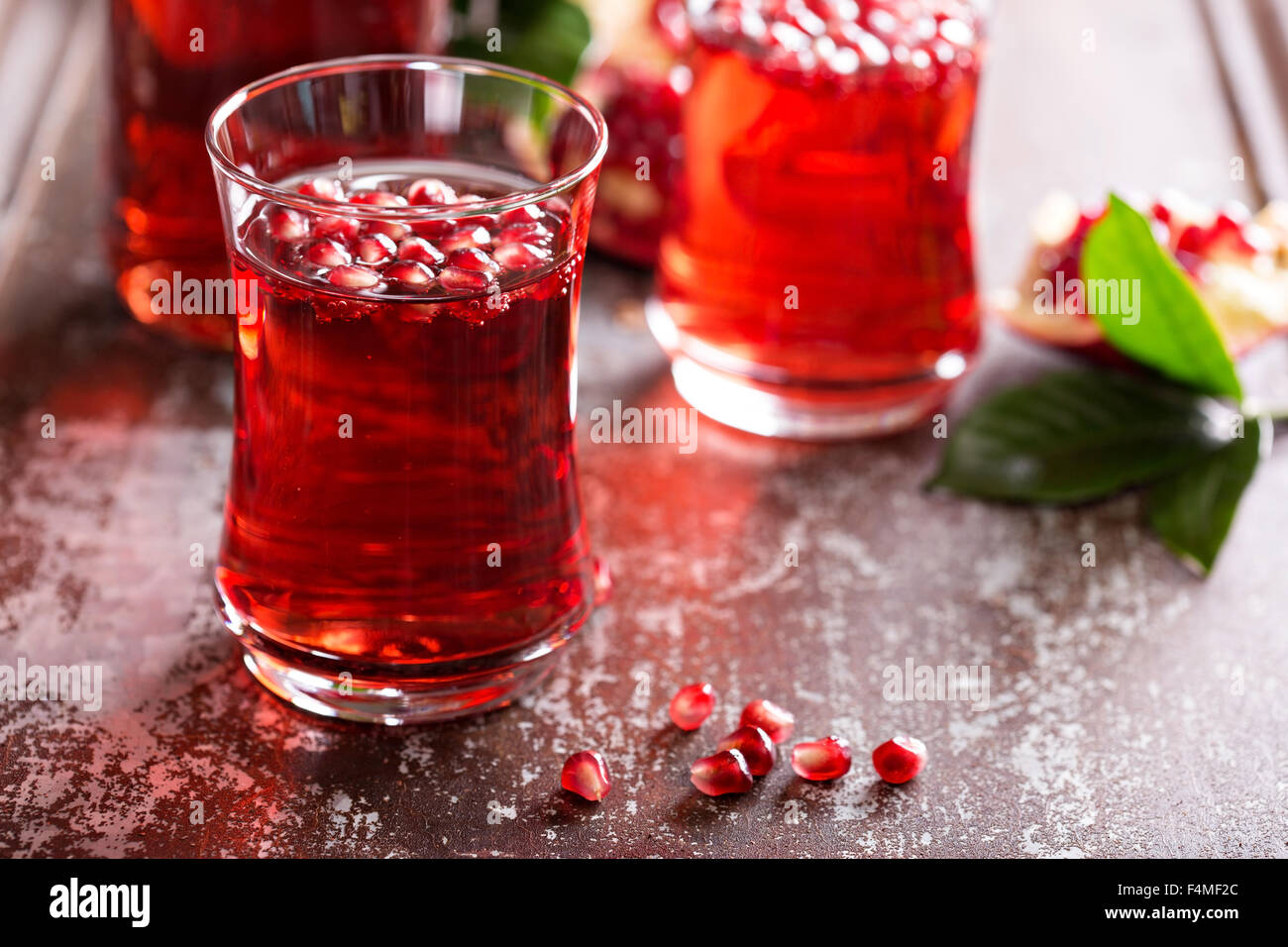 Pomegranate drink with sparkling water fall cold beverage - Stock Image