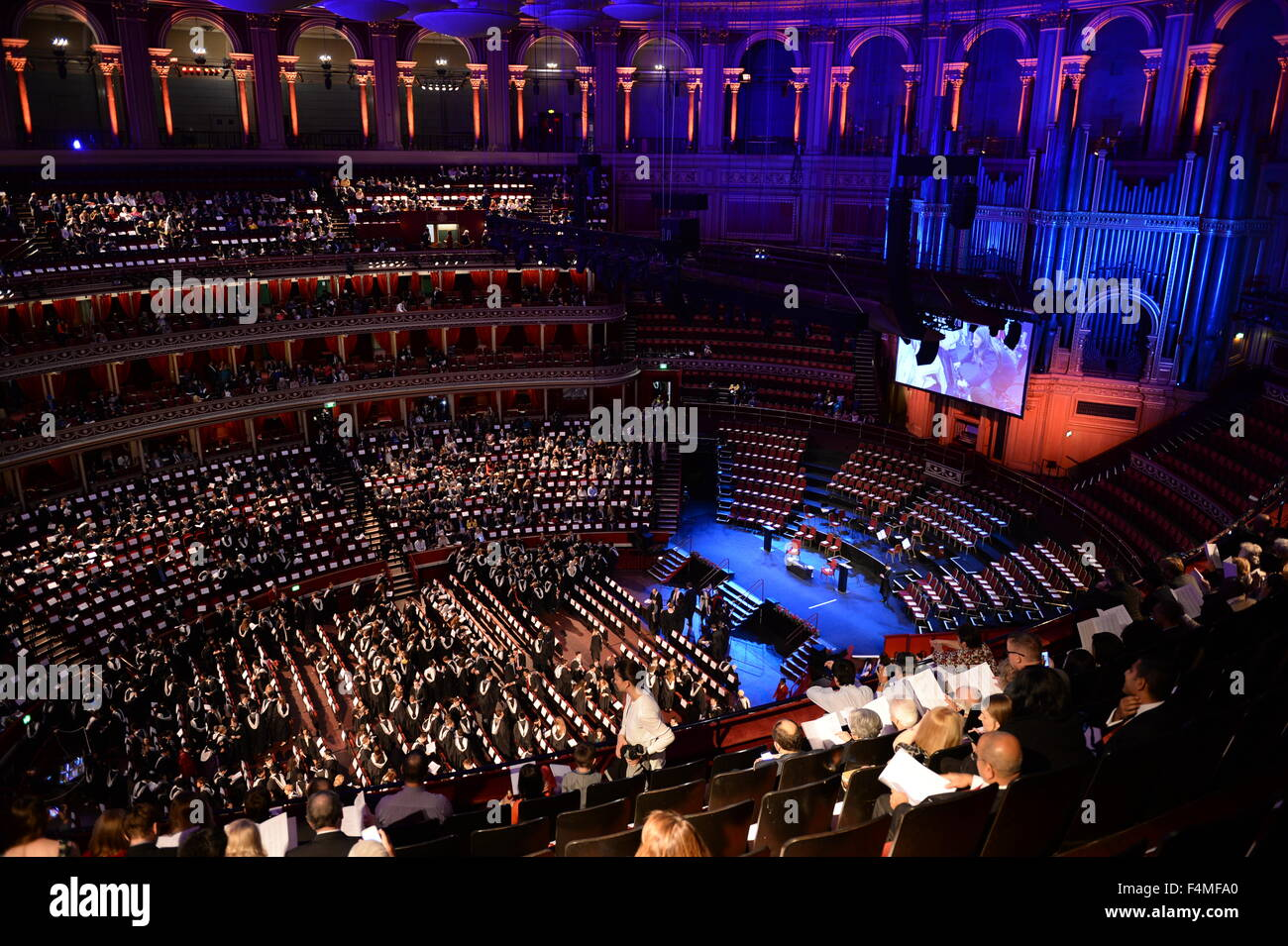 Inside the Royal Albert Hall graduates and families on Imperial College London Commemoration day - Stock Image