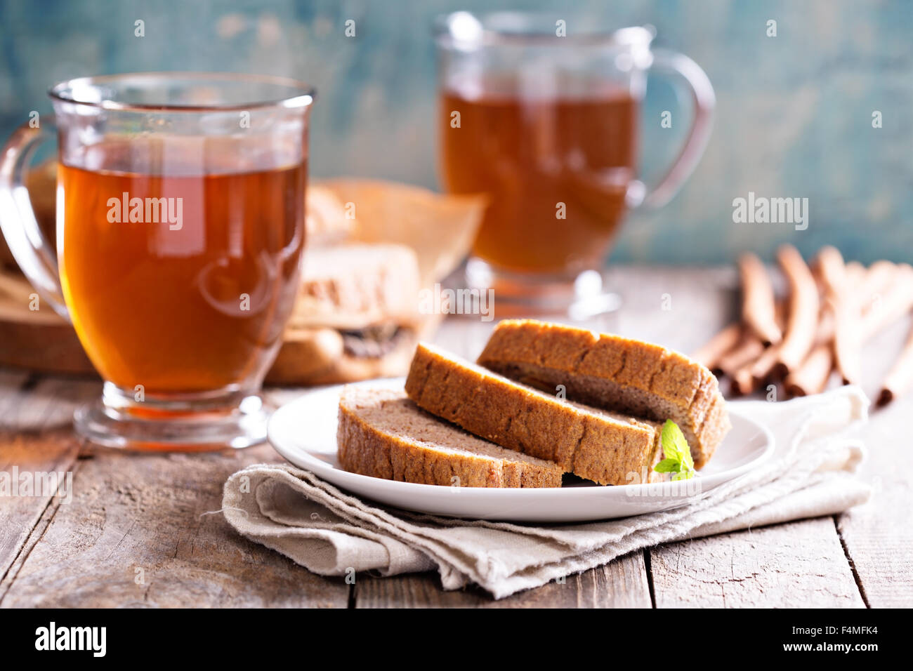 Gingerbread warm and spicy loaf cake with hot tea - Stock Image
