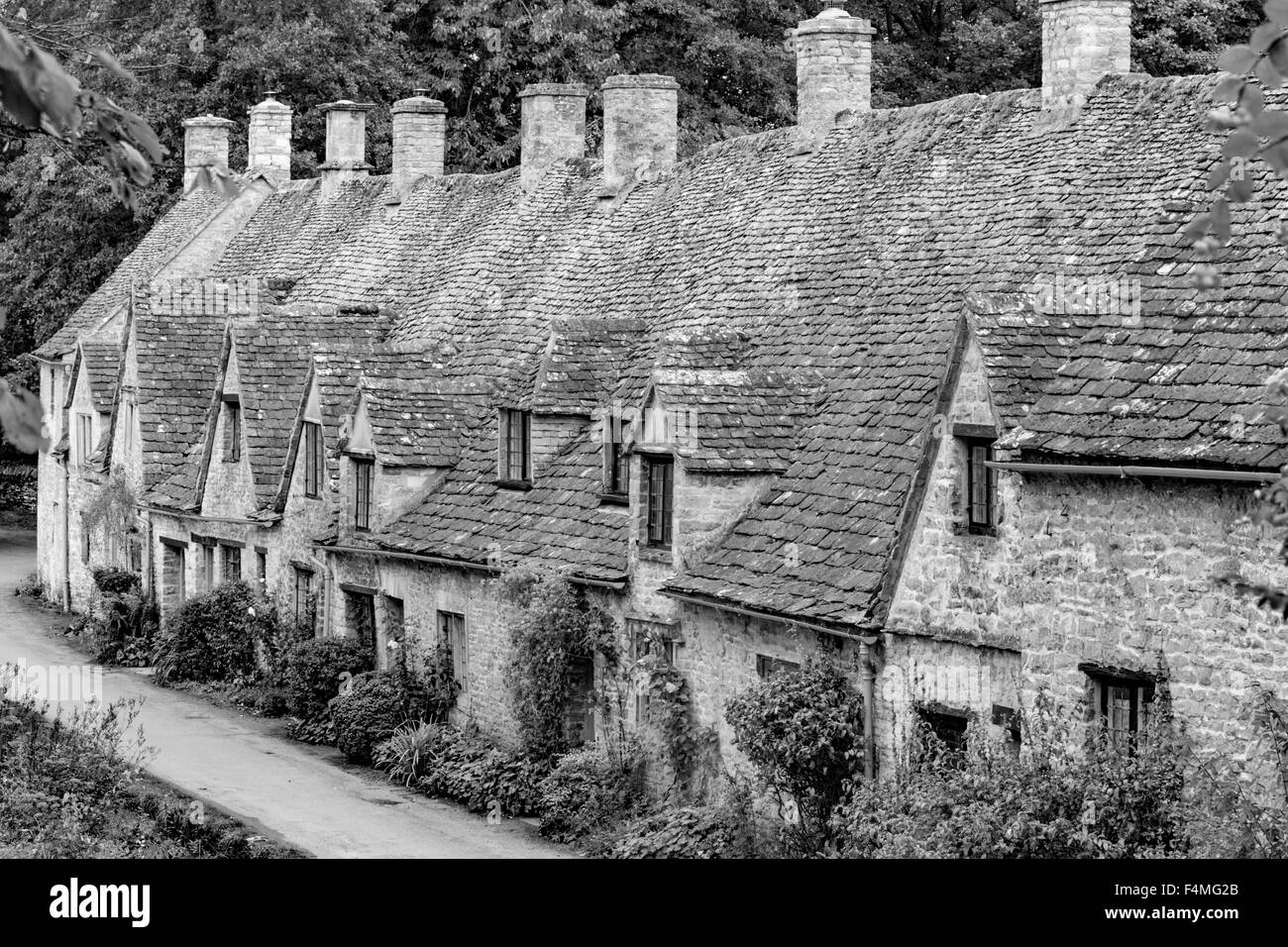 A monochrome view of Arlington Row in the Cotswold village of Bibury, Gloucestershire, England, UK - Stock Image