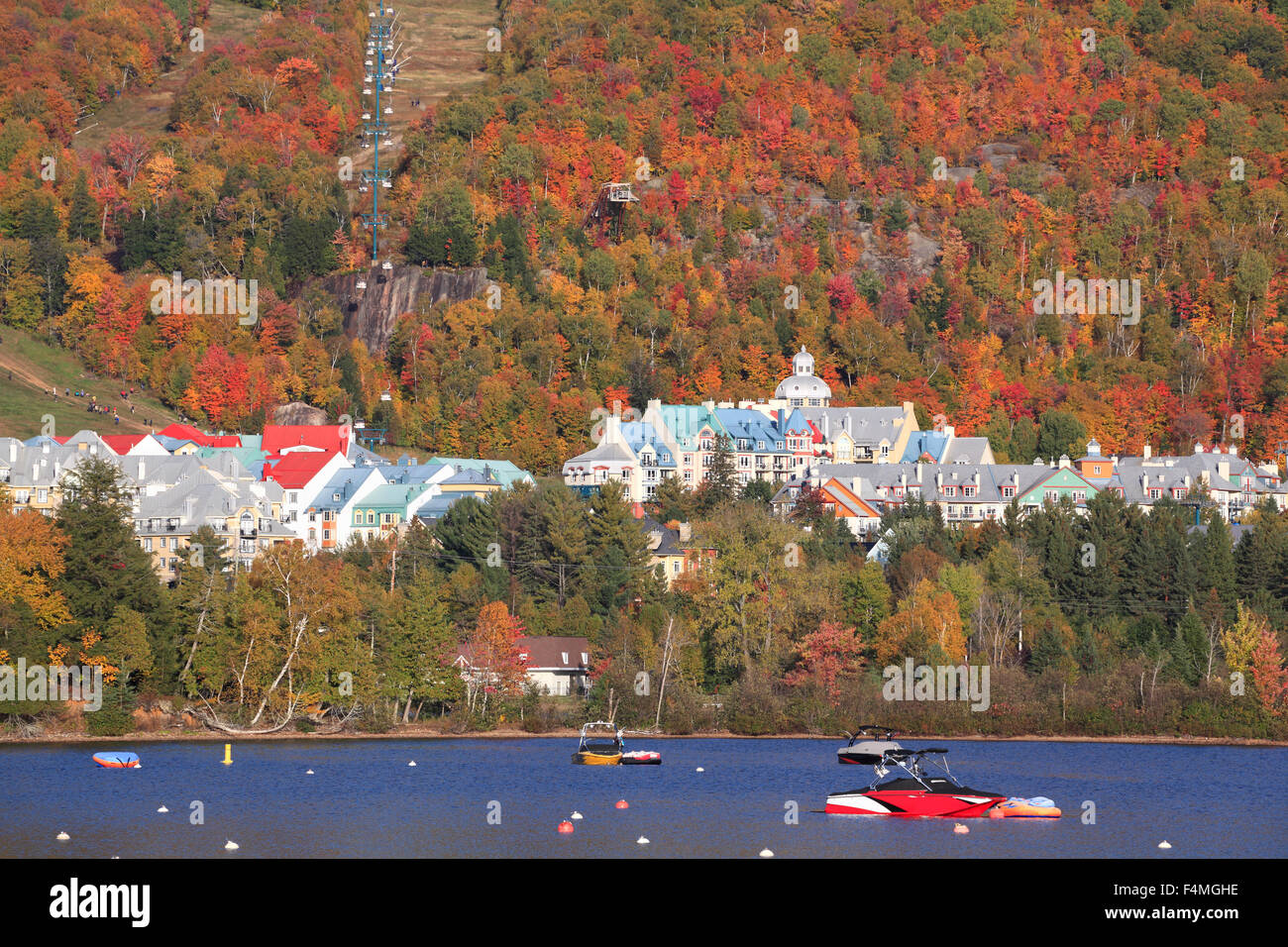 Mont Tremblant lake and village with autumn colors, Quebec, Canada - Stock Image