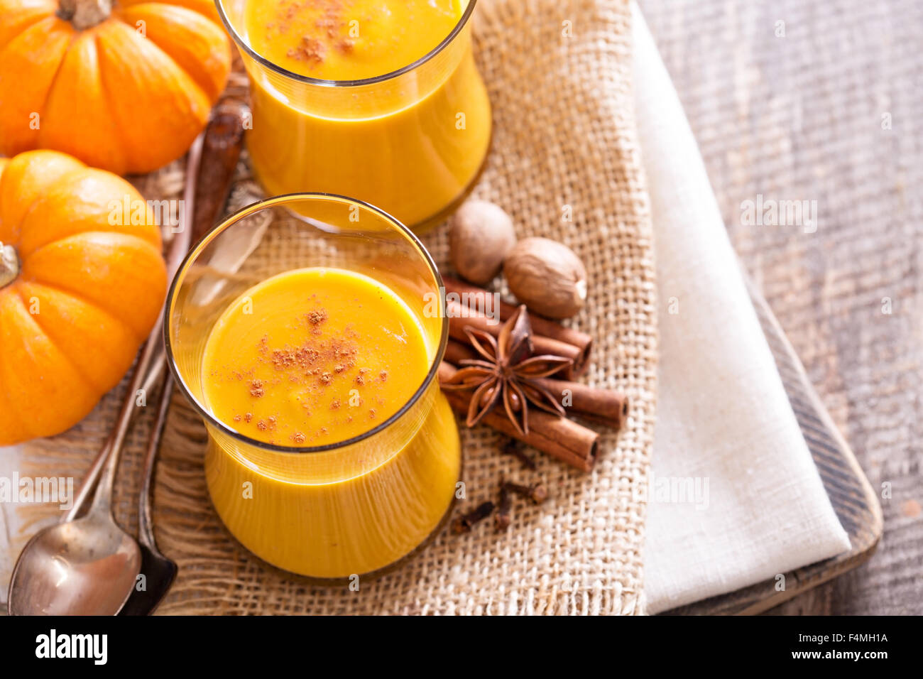 Pumpkin and orange spiced fall drink with cinnamon - Stock Image