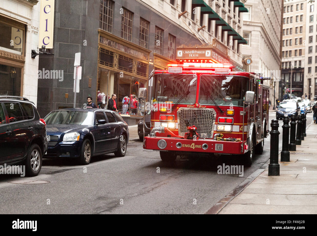 A Fire Truck From The Boston Fire Department With Lights On Going To A 911  Emergency