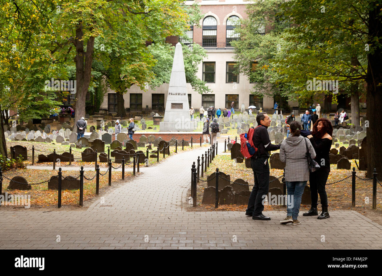 Visitors at the Old Granary Burial Ground on the Freedom Trail, Boston Massachusetts USA - Stock Image