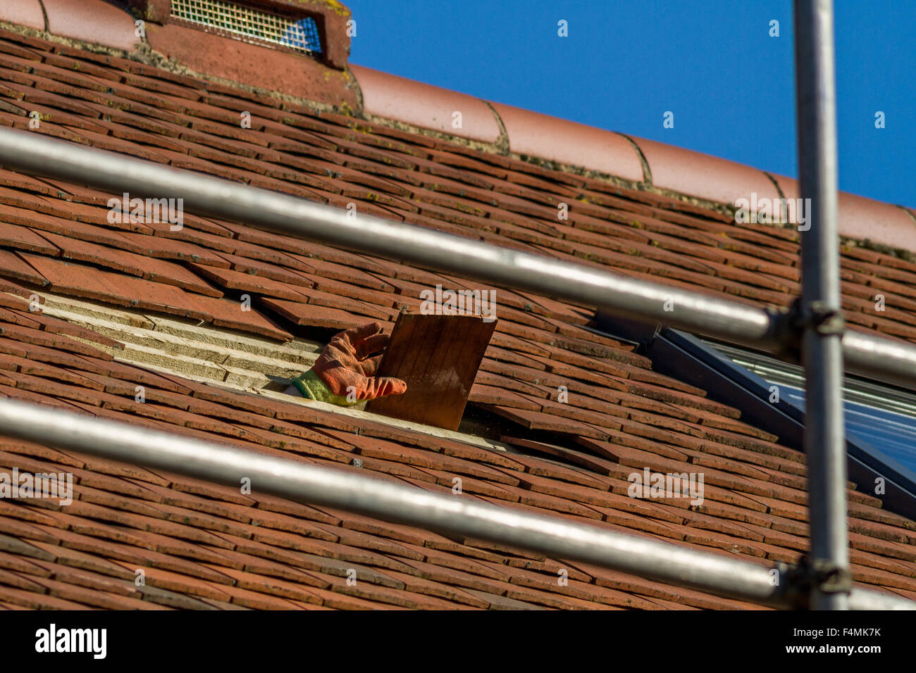 Creating a window in the roof of a loft conversion - Stock Image