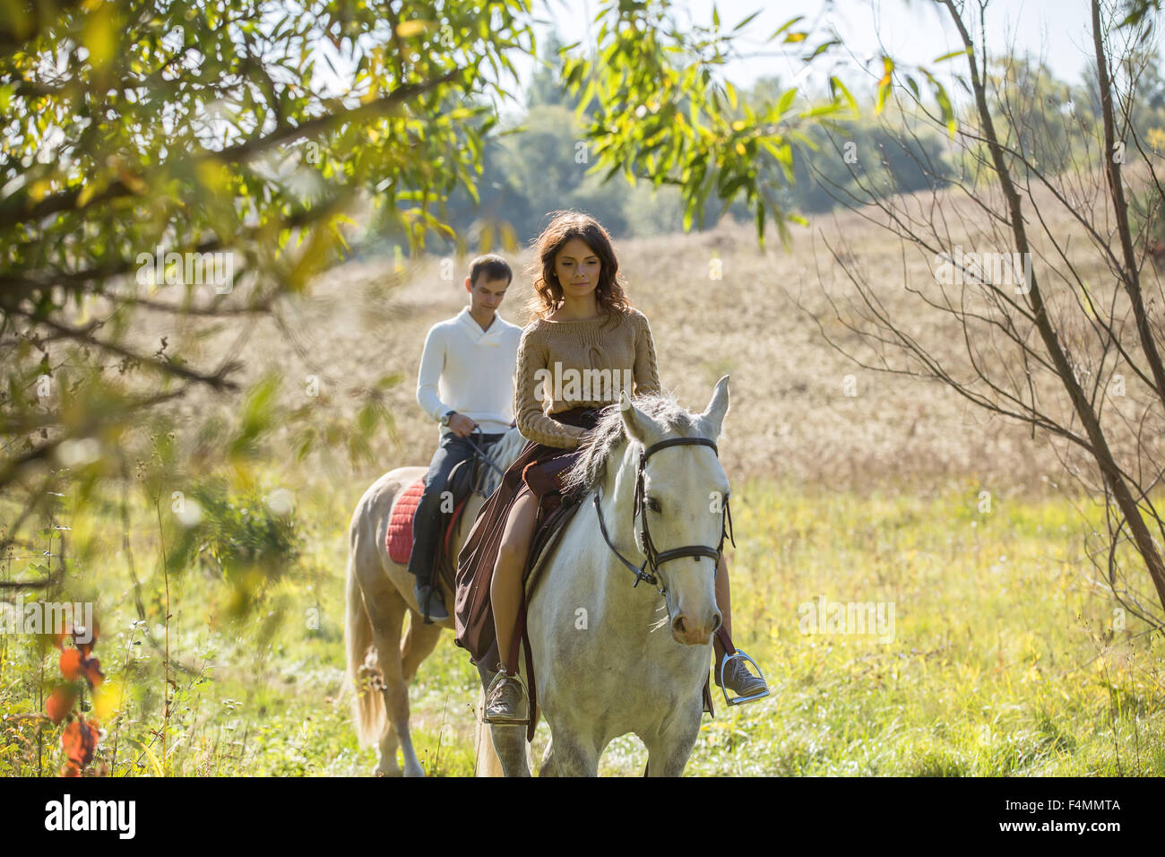 Young couple riding Stock Photo