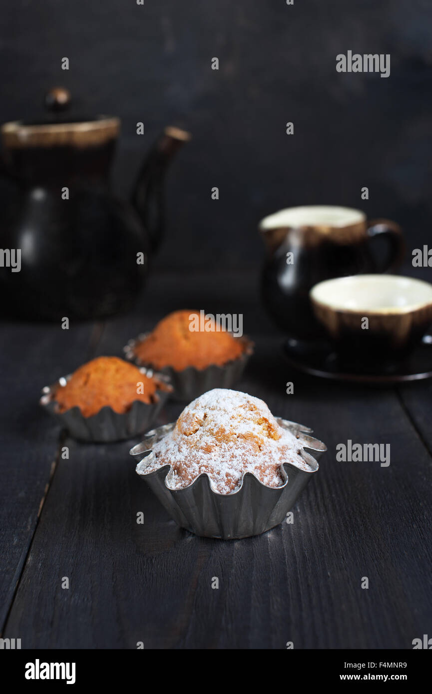 Cupcake on the wooden table - Stock Image