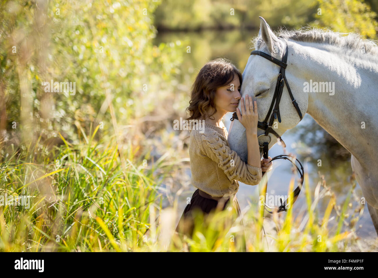 Beautiful girl with the white horse - Stock Image