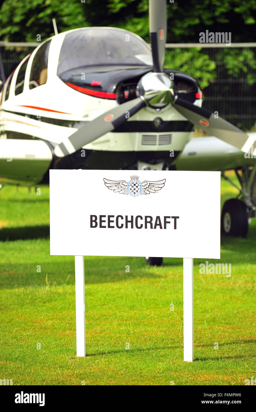 A Beechcraft sign by a Beechcraft aircraft at the Goodwood Festival of Speed in the UK. - Stock Image