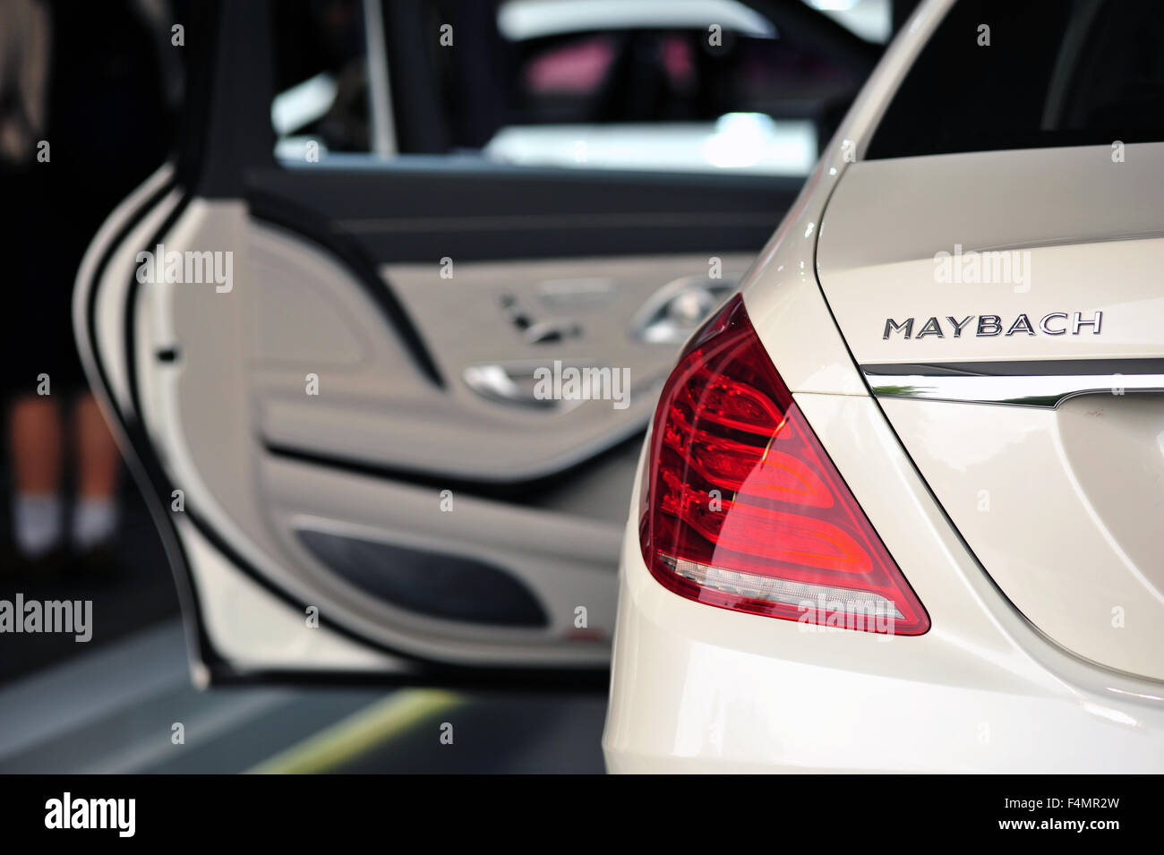 The Rear Of A Maybach Luxury Car With Its Door Open At The Goodwood