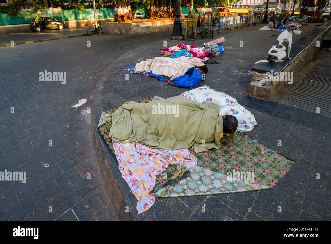 Homeless people are living under extrem conditions, sleeping on the pedestrian path Stock Photo