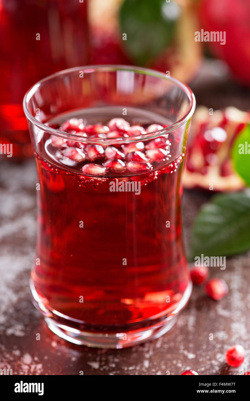 pomegranate drink with sparkling water fall cold beverage stock