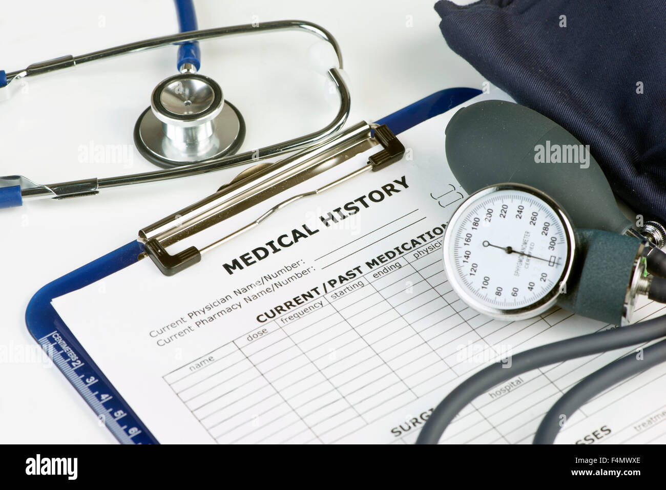 Patient chart with stethoscope and blood pressure cuff. - Stock Image
