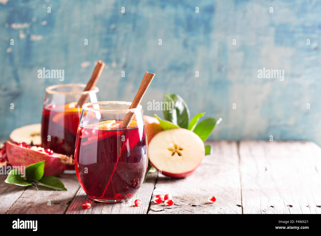 Fall and winter sangria with apples, oranges, pomegranate and cinnamon - Stock Image