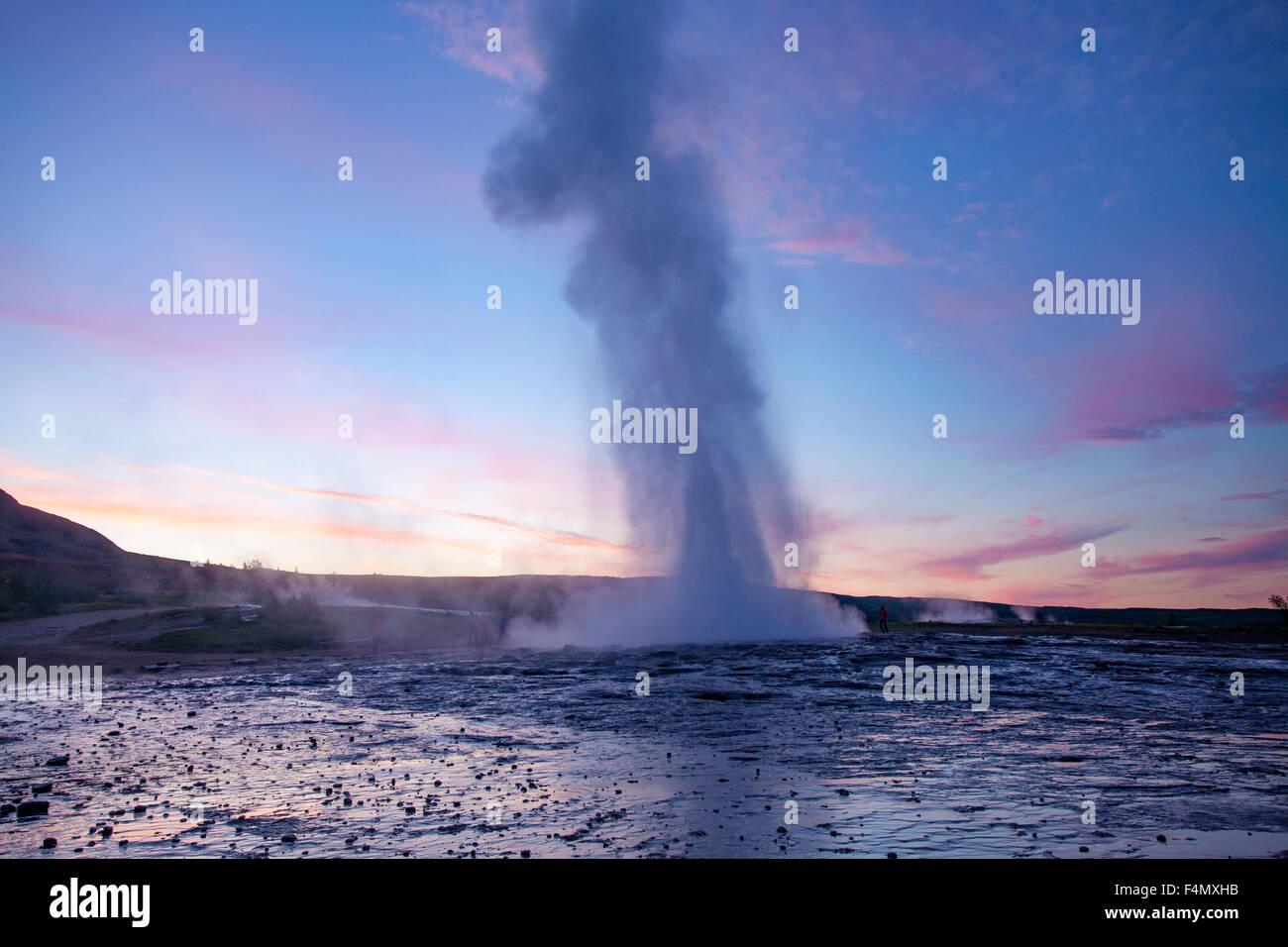 Strokkur geyser errupting at sunset, Geysir, Sudhurland, Iceland. - Stock Image