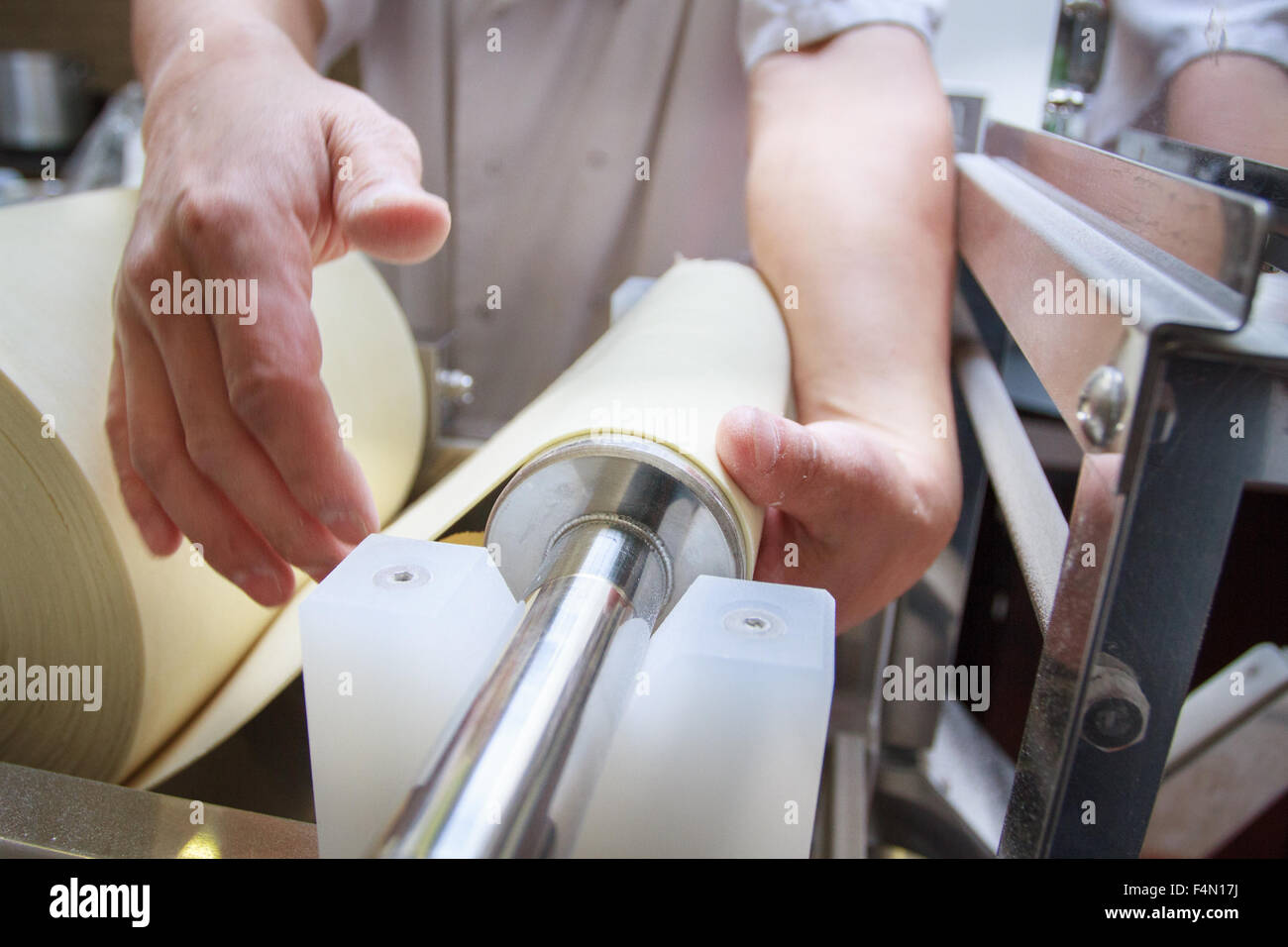 Roll of Dough sheet on a Japanese Ramen Noodles making machine - Stock Image