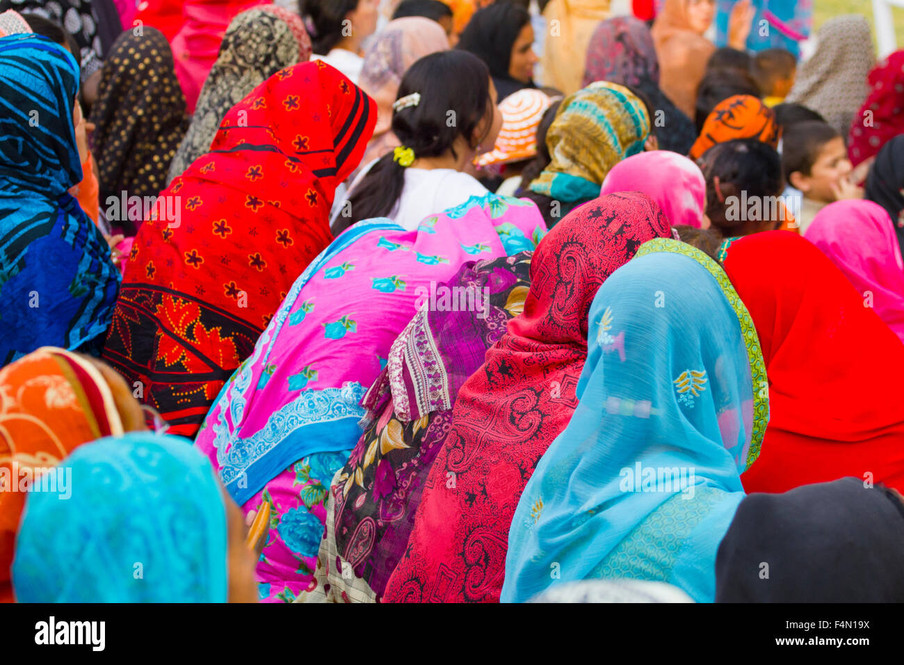 Muslim women wearing colorful headscarves, duppattas and hijabs - Stock Image