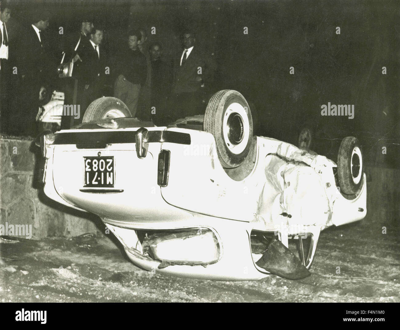 Car upside down after accident, Italy - Stock Image
