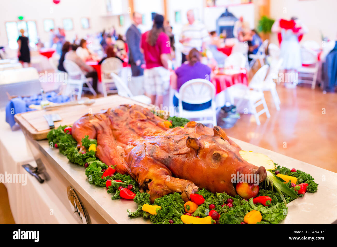 Whole Pig At A Wedding Reception With An Apple In Its Mouth On A