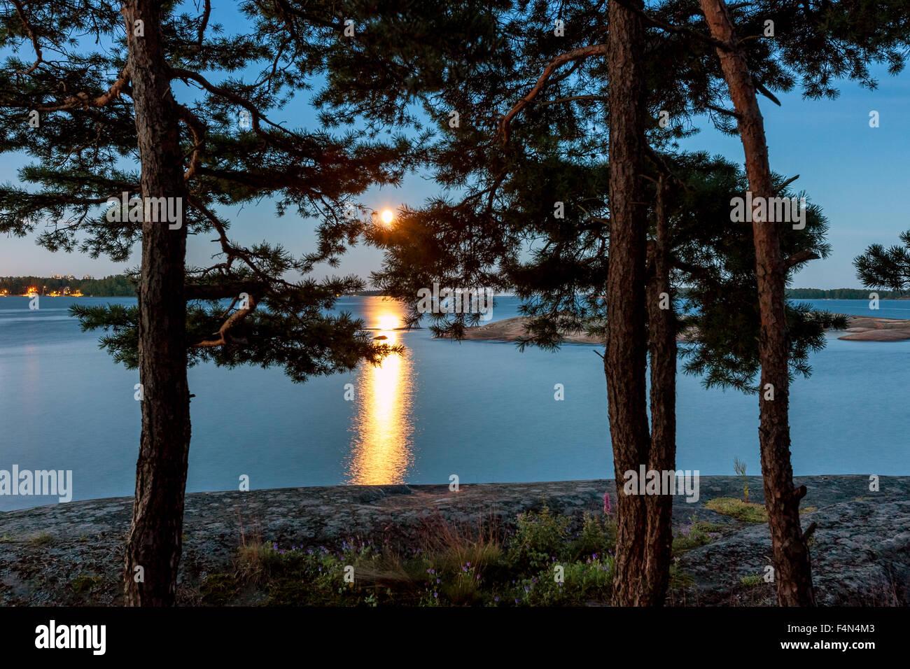 Moon rising at Läntinen Käärmeluoto island, Helsinki, Finland, Europe, EU - Stock Image
