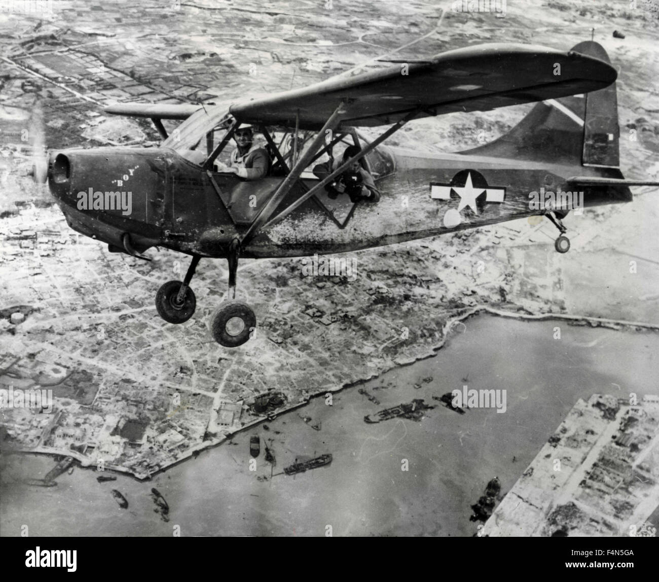 American air reconnaissance Grasshopper flies over Okinawa, Japan - Stock Image