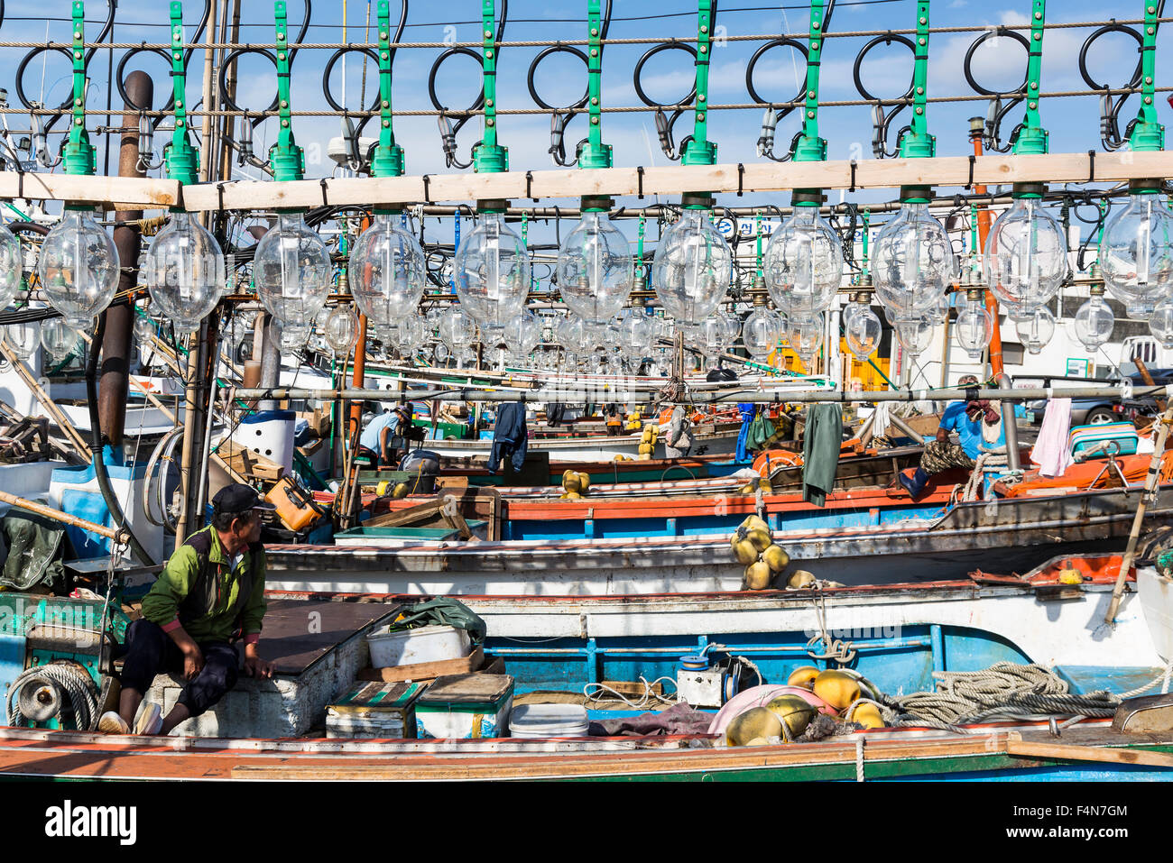 Jeju Island Squid Fishing Boats lights and fishermen Stock Photo
