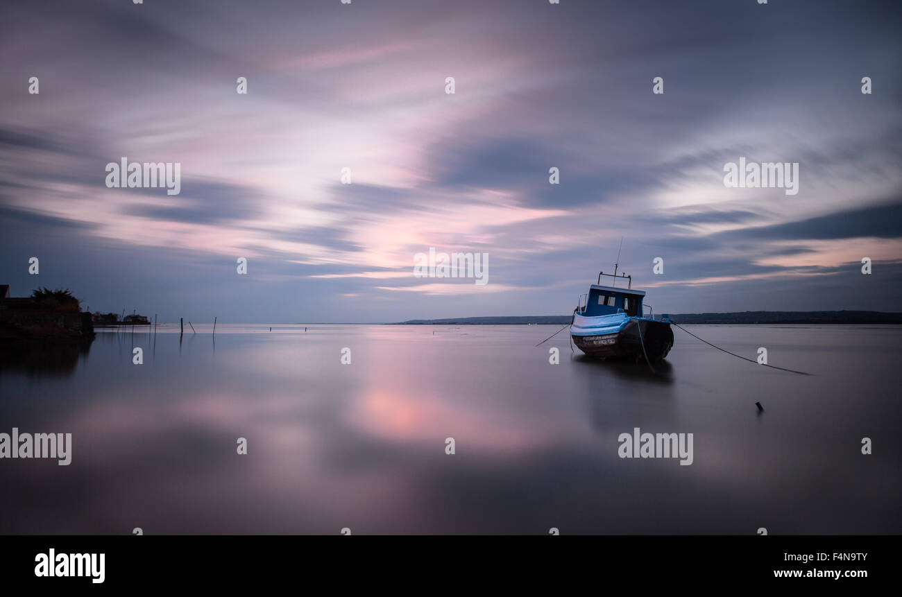 Loughor estuary boat Long exposure at the Loughor Estuary, Penclawdd, north Gower, Swansea. Stock Photo