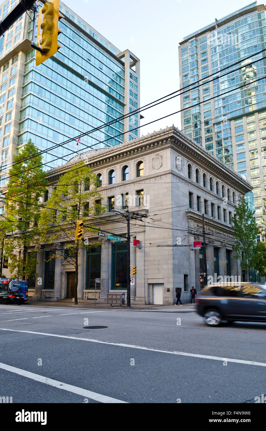 Corner of Hastings Street and Seymour in downtown Vancouver.  Morris J. Wosk Centre for Dialogue building and office - Stock Image