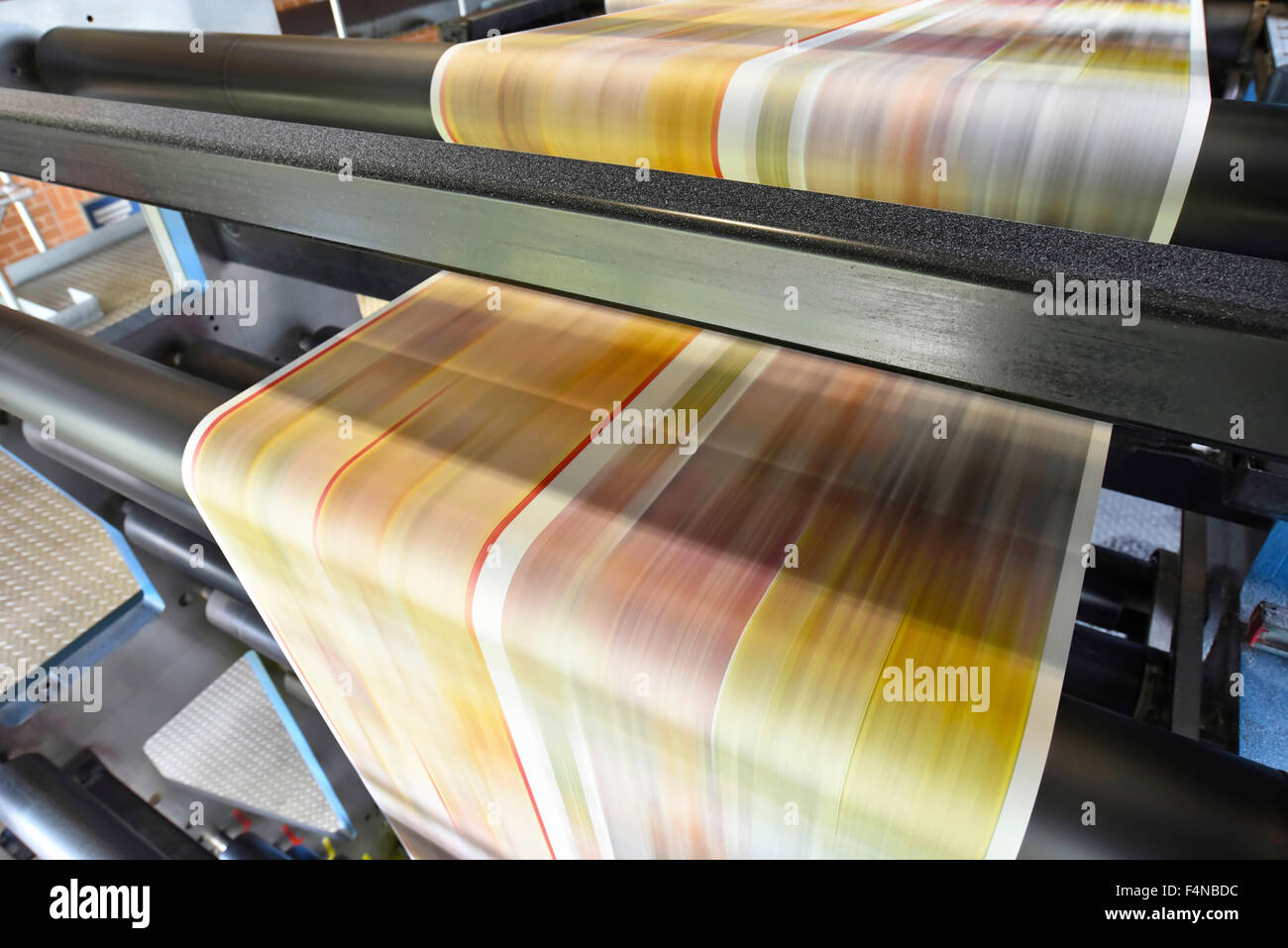 Printing machine in a printing shop - Stock Image