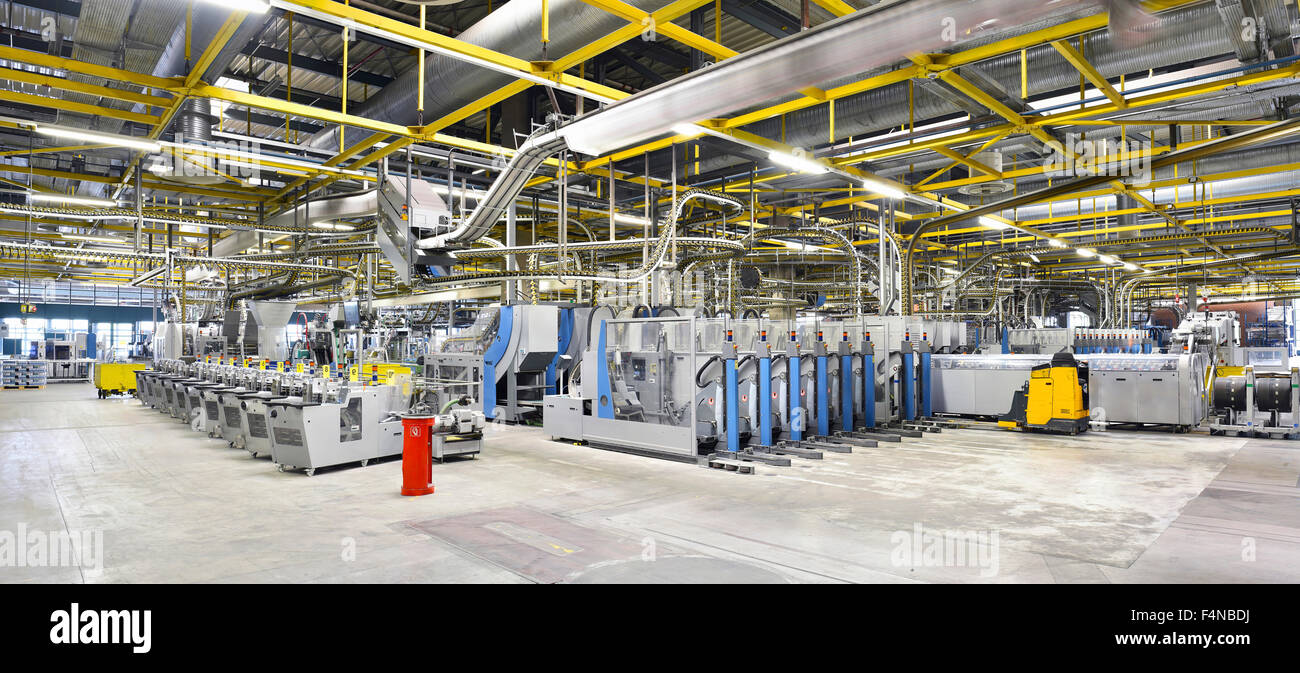 Machines for transport and packaging in a printing shop - Stock Image