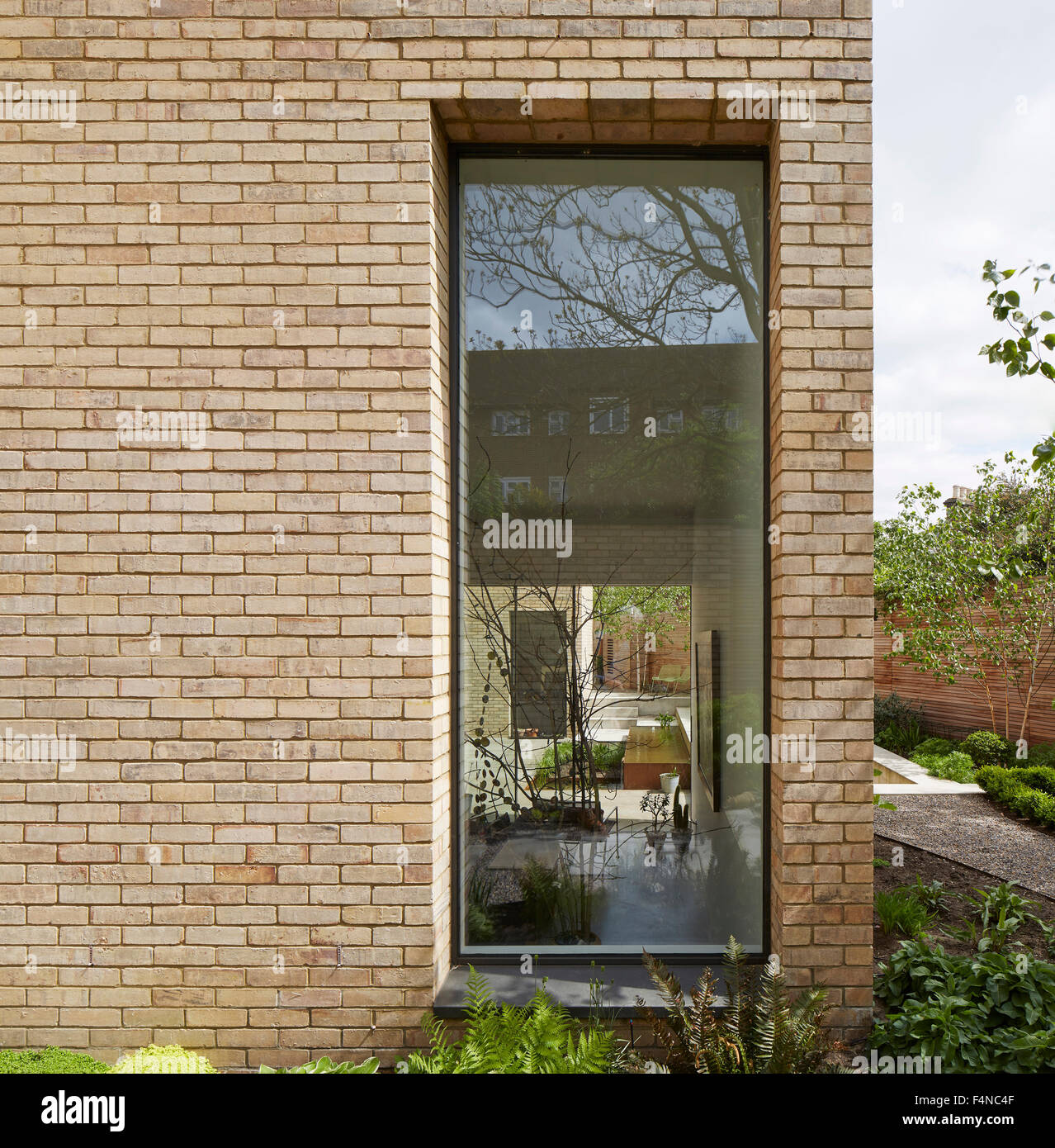 View through recessed window. Luker House, London, United Kingdom. Architect: Jamie Fobert Architects, 2014. - Stock Image
