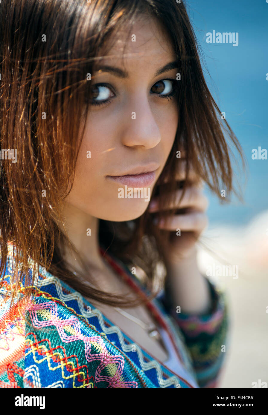 Portrait of young woman with brown hair and brown eyes - Stock Image