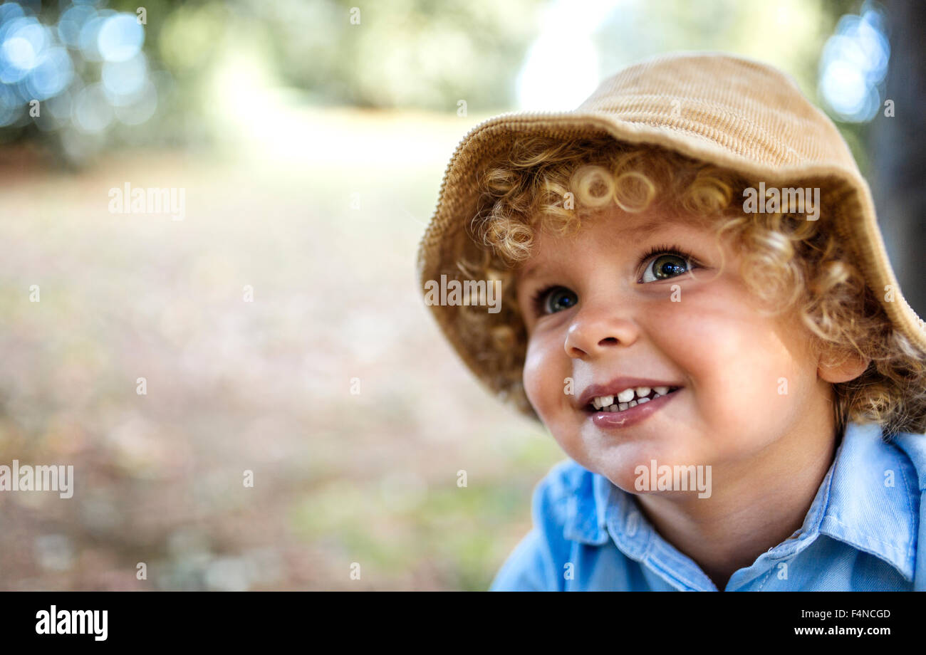 b2ede0cccc0 Portrait of smiling blond little boy wearing hat Stock Photo ...