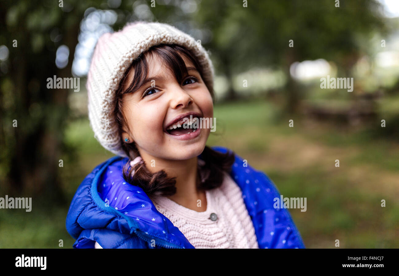 Portrait of laughing little girl with tooth gap - Stock Image