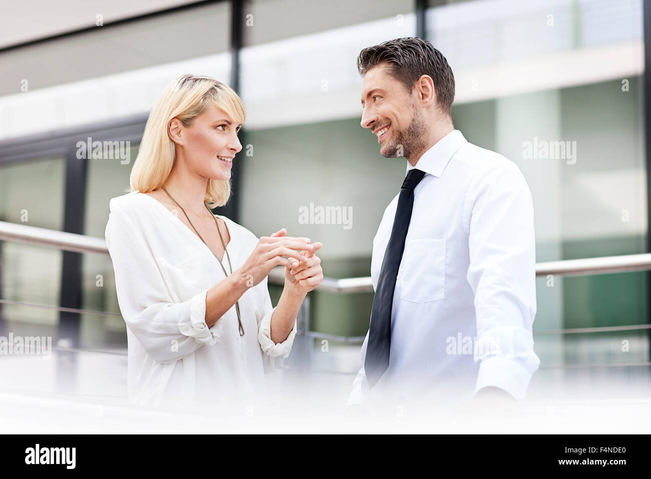 Businesswoman explaning something to her business partner - Stock Image