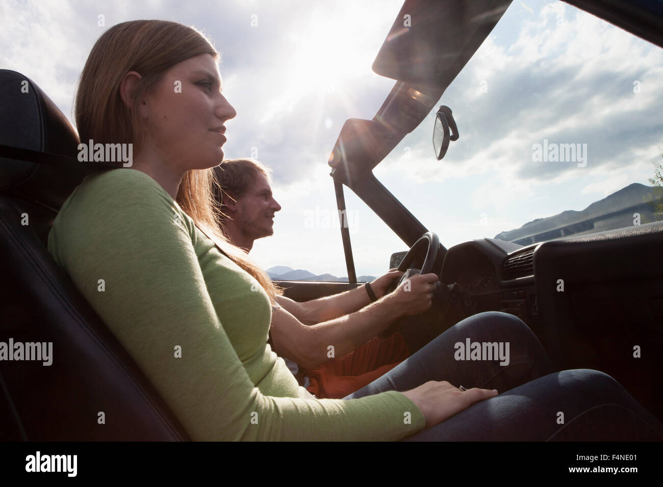 Germany, Bavaria, couple in a convertible - Stock Image