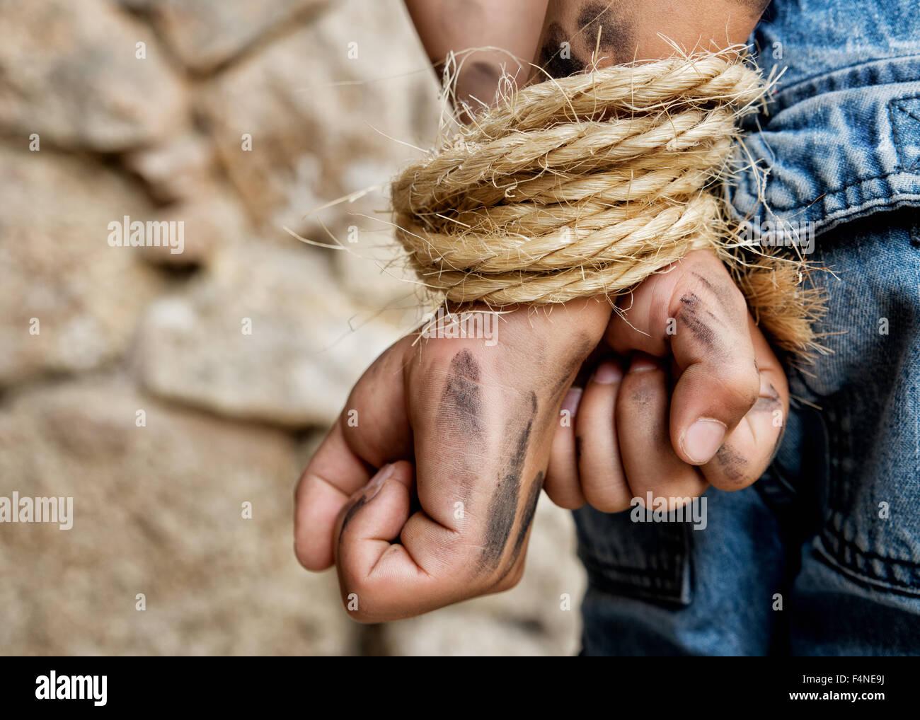 Prisoner bound with rope - Stock Image